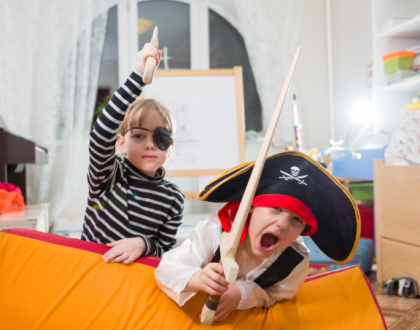 Girl and boy playing pirates